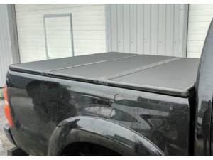 Крышка алюминиевая трехсекционная Kramco на Nissan Navara D40 (2005-)