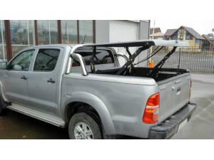 Крышка кузова Top Up Euro Star с дугой безопасности на Toyota Hilux (2006-2014)