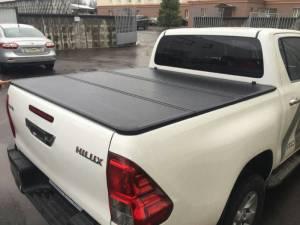 Крышка алюминиевая трехсекционная Winbo на Toyota Hilux Revo (2015-2018)